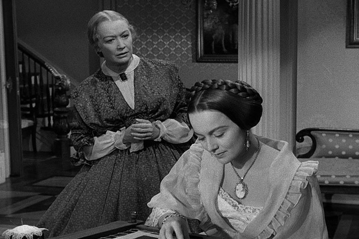 Miriam Hopkins, Olivia de Havilland.png