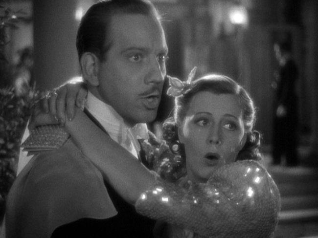 Melvyn Douglas, Irene Dunne in Theodora Goes Wild