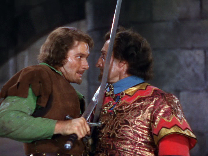 Errol Flynn, Basil Rathbone in The Adventures of Robin Hood