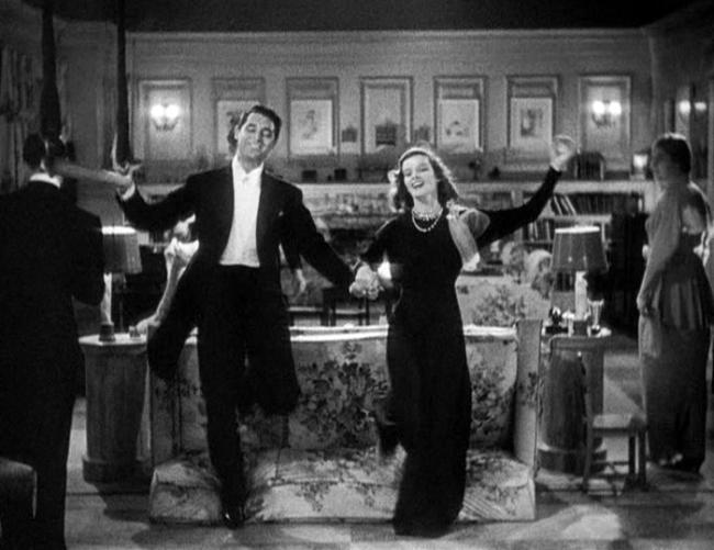 "Cary Grant, Katharine Hepburn star in ""Holiday."""