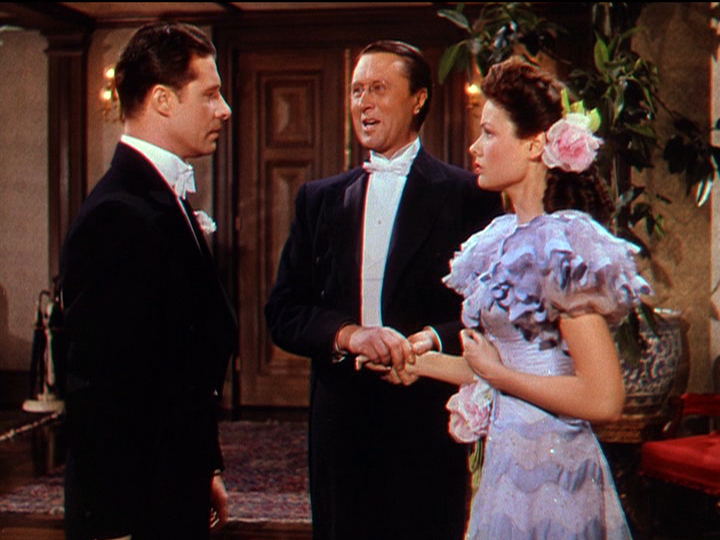 Don Ameche meets his cousin's fiancee, Gene Tierney, in Heaven Can Wait