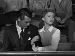 "Cary Grant, Shirley Temple watch basketball together in ""The Bachelor and the Bobby Soxer"""