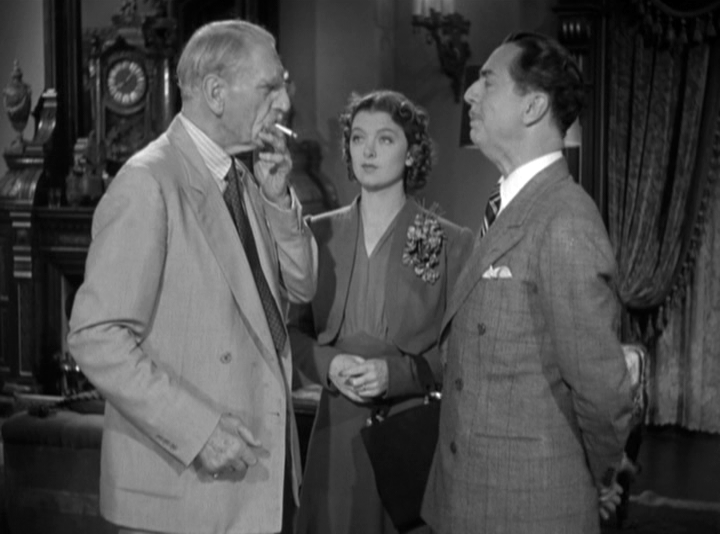 The Colonel (C. Aubrey Smith) explains why he thinks someone is trying to murder him to Nick and Nora Charles (William Powell, Myrna Loy).