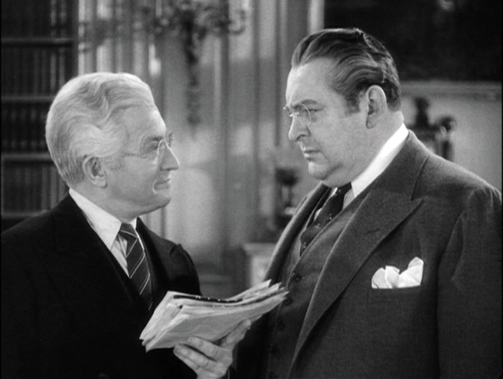 Claude Rains and Edward Arnold plot to appoint a pushover Senator.