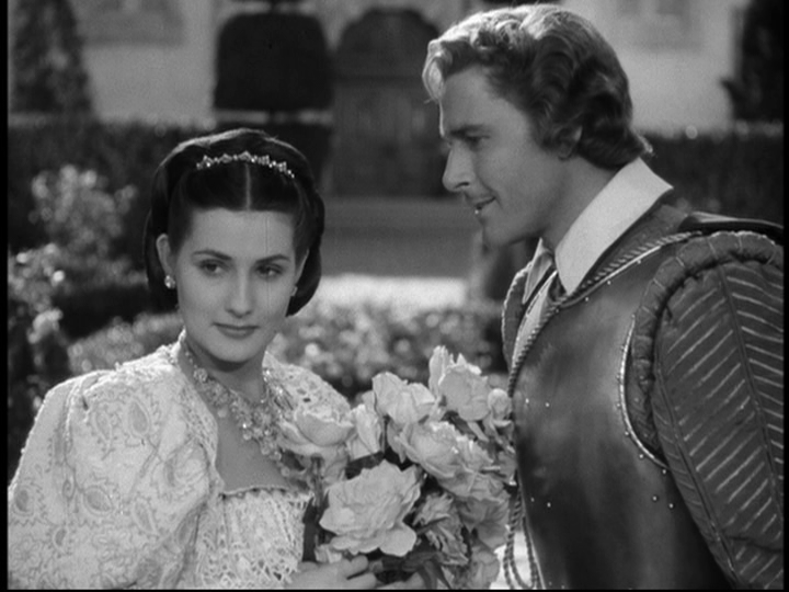 Dona Maria (Brenda Marshall) is wooed by Captain Thorpe (Errol Flynn).