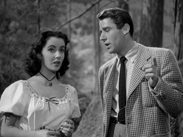 Peter Lawford explains the ways of love to Elizabeth Taylor.