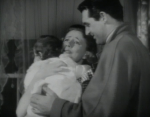 Irene Dunne, Cary Grant hold their newly adopted daughter in Penny Serenade