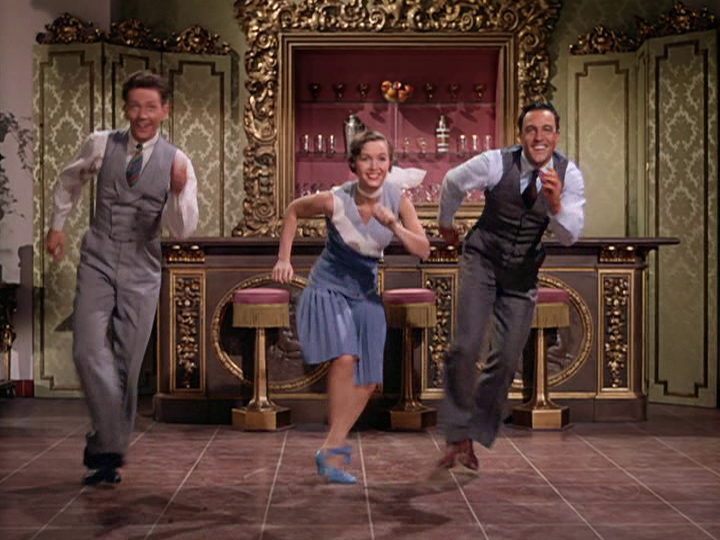 "Donald O'Connor, Debbie Reynolds, and Gene Kelly dance the night away in ""Singin' in the Rain."""
