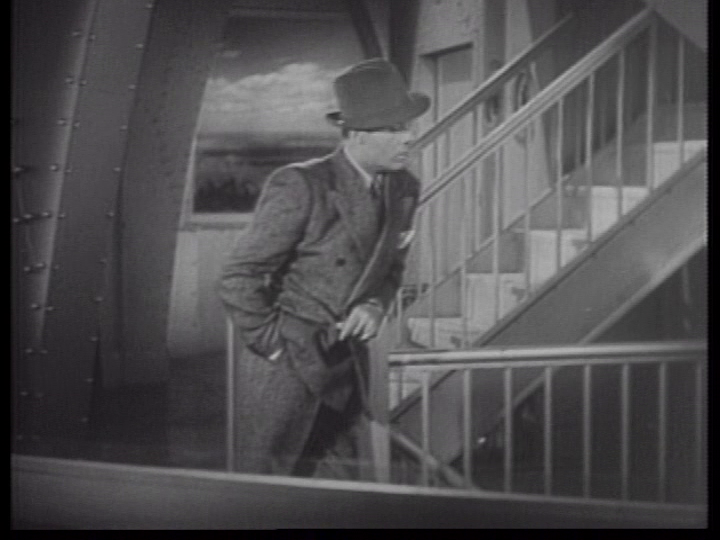 Charles Boyer waits for Irene Dunne at the Empire State Builidng.