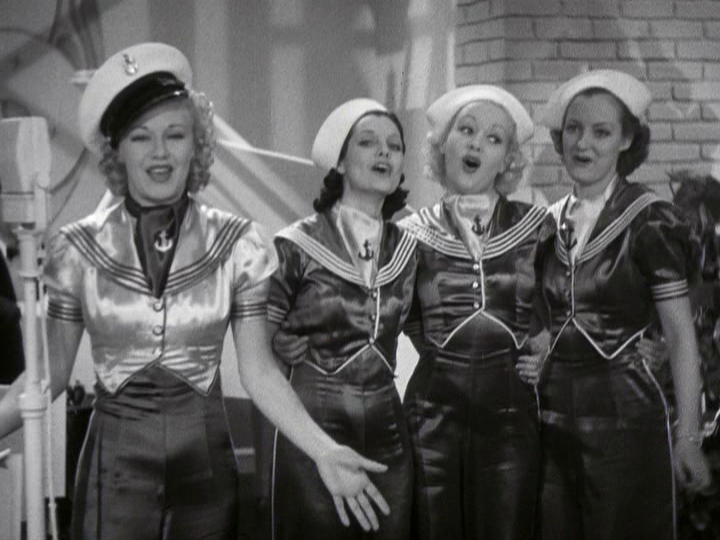 Ginger Rogers and three female backup singers put on a show for incoming sailors.