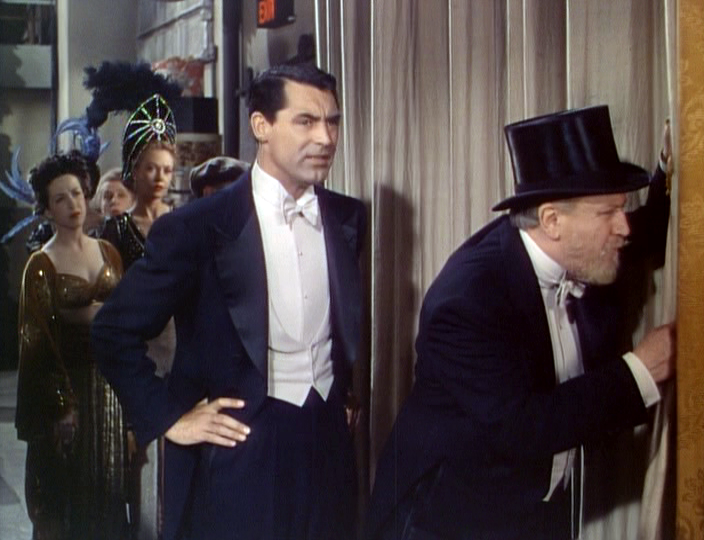 Cary Grant (as Cole Porter) and Monty Woolley (as himself) peer at the audience on opening night.