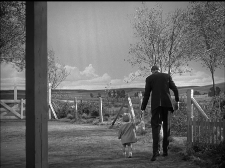 James Stewart as Monty Stratton and his son learn to walk together.