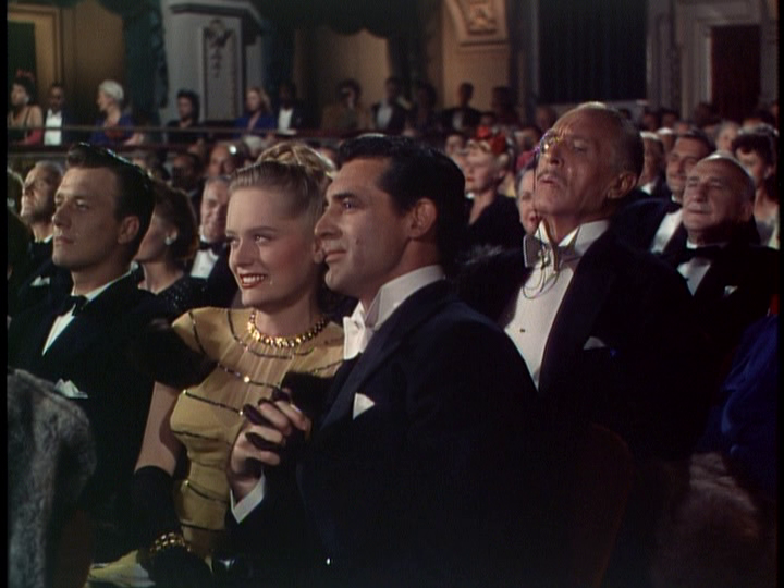 Alexis Smith and Cary Grant enjoy an evening of Cole Porter music.