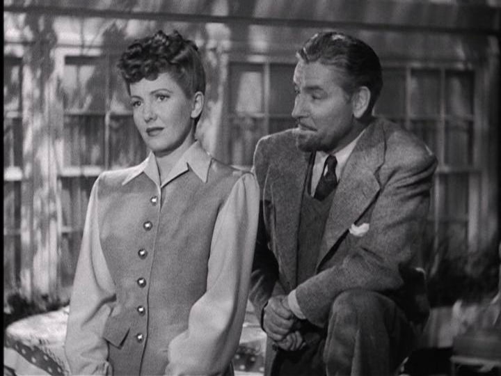 """Ronald Colman proposes to Jean Arthur in """"The Talk of the Town."""""""