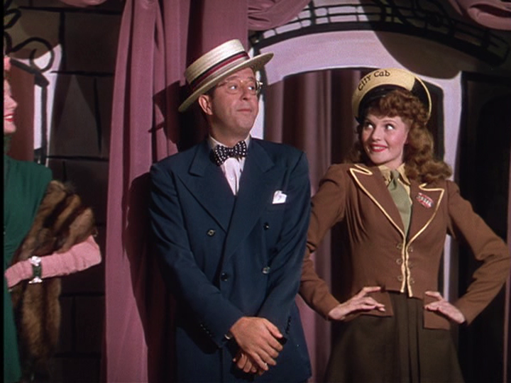Phil Silvers, Rita Hayworth share a dance number in Cover Girl.