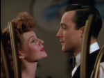 "Rita Hayworth, Gene Kelly serenade each other in ""Cover Girl."""
