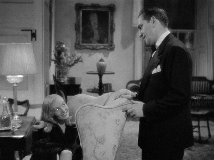 "Veronica Lake casts her spell on Fredric March in ""I Married a Witch."""
