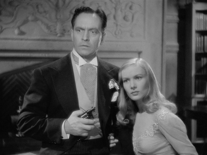 Wallace (Fredric March) and Jennifer (Veronica Lake) listen to her father describe how Wallace which reach the end of his career--and his life.describe how