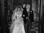 Elizabeth Taylor and Spencer Tracy walk down the aisle.