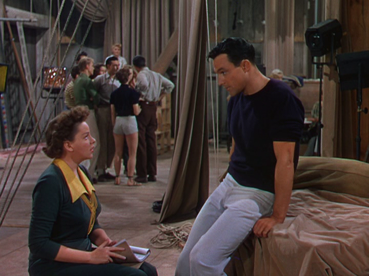 "Judy Garland and Gene Kelly discuss the upcoming performance in ""Summer Stock."""