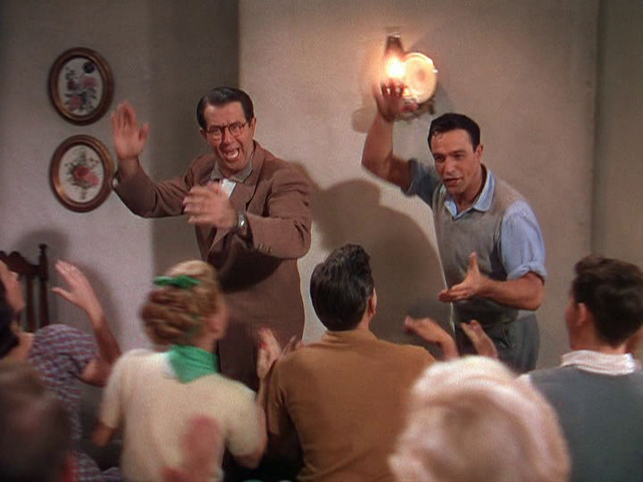 "Phil Silvers and Gene Kelly dance for the troupe in ""Summer Stock."""