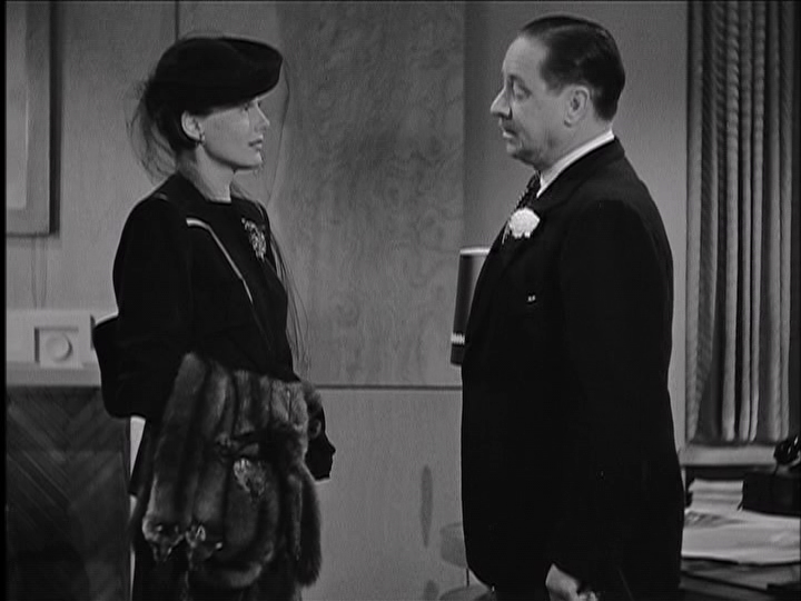 """Frieda Inescort and Robert Benchley discuss the tenuous state of their marriage in """"You'll Never Get Rich."""""""