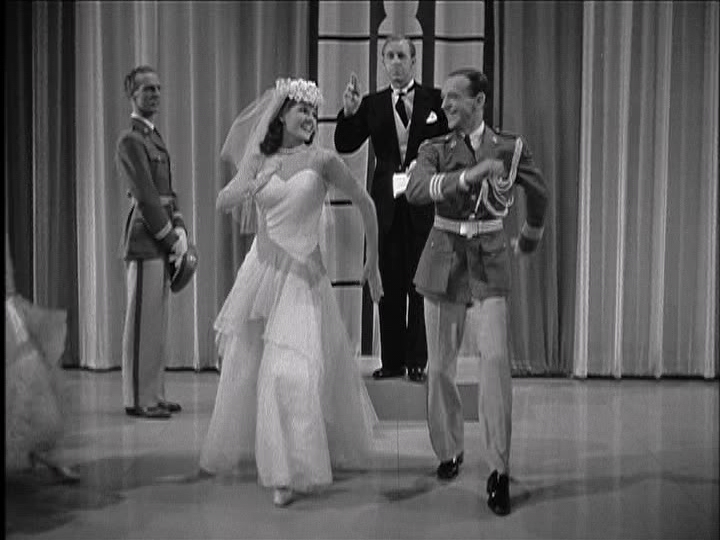 """Rita Hayworth and Fred Astaire dance in a """"wedding cake dance"""" routine for the troops in """"You'll Never Get Rich."""""""