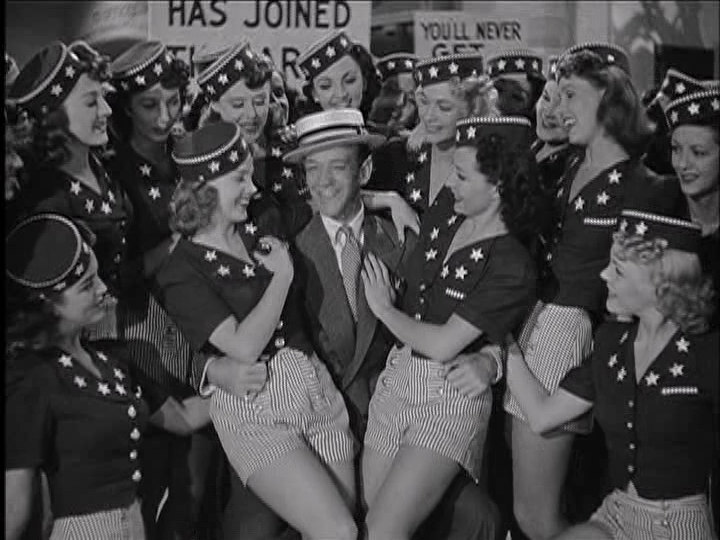 """Fred Astaire amidst a bevy of showgirls in """"You'll Never Get Rich."""""""