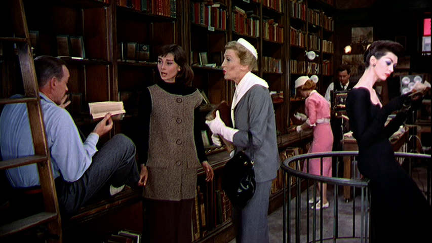 Fred Astaire, Audrey Hepburn, Kay Thompson argue about Fred and Kay's plan for a photo shoot in Audrey's bookstore